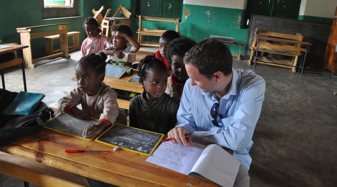 A Projects Abroad volunteer has a personal conversation with a young student in Madagascar while doing his Teaching English project.